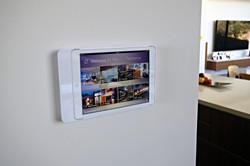White iPad wall-mounted controller