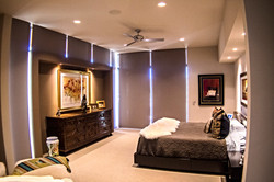Bedroom with closed motorized shades