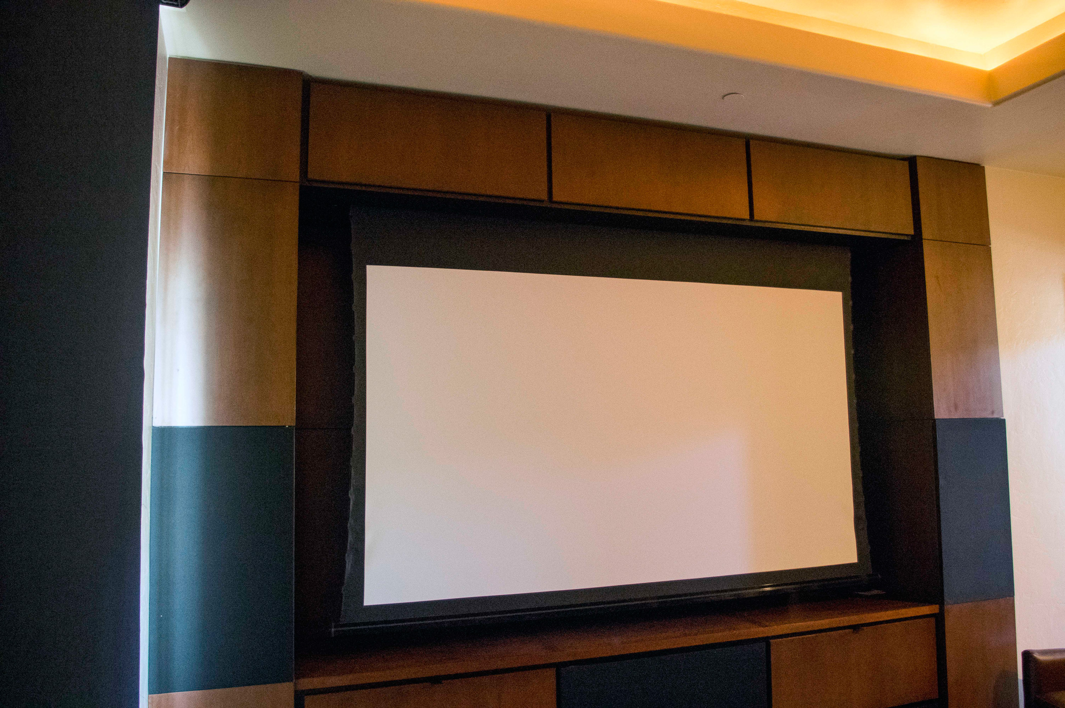 Automated projector screen in theate