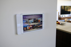 White wall-mounted iPad controller