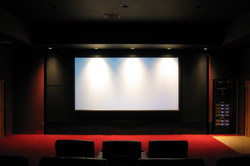 Projection screen by equipment rack