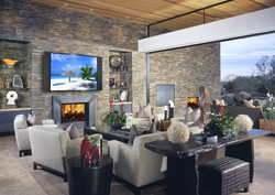 Grey stone living room with a TV