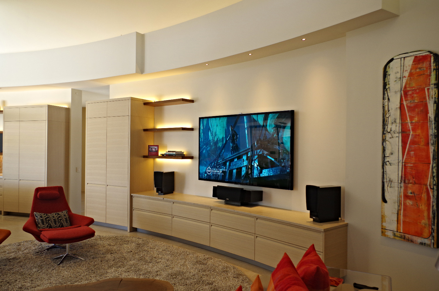 TV hanging in designer living room