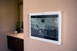 White wallmounted Control4 touchpad