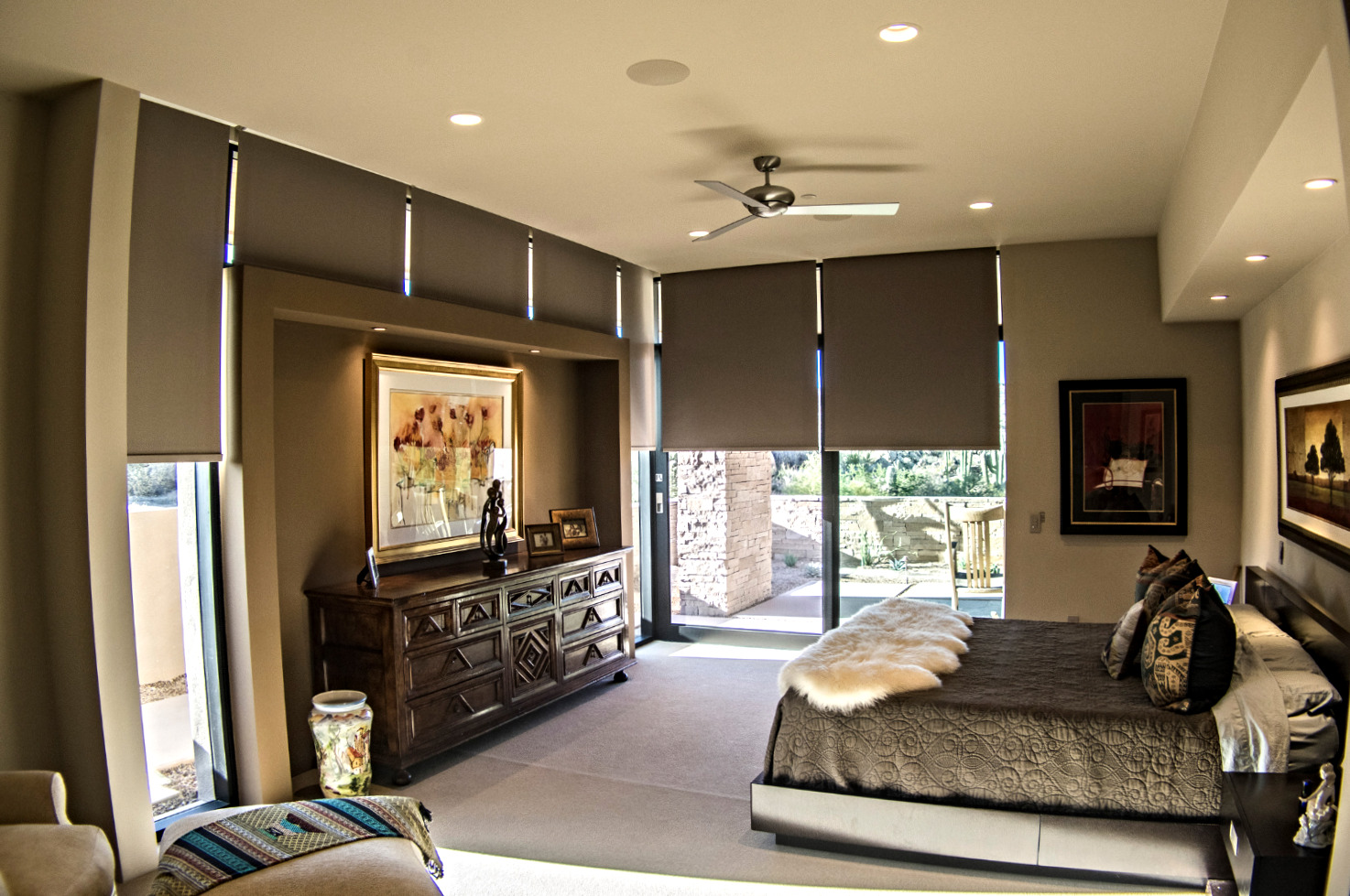 Bedroom with motorized shades