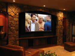 Custom home theater w/ stone accents