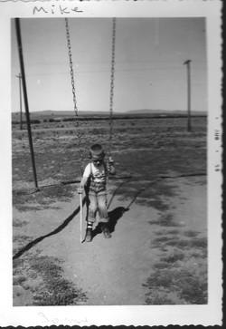 Mike Hendricks on swings
