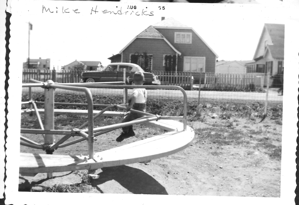 Mike Hendricks on school merry-go-round