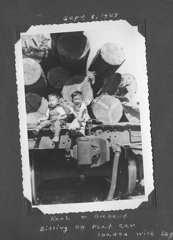 Karl and Gil on log car