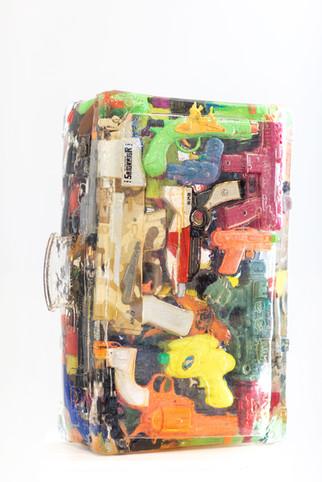 Suitcase plastic guns