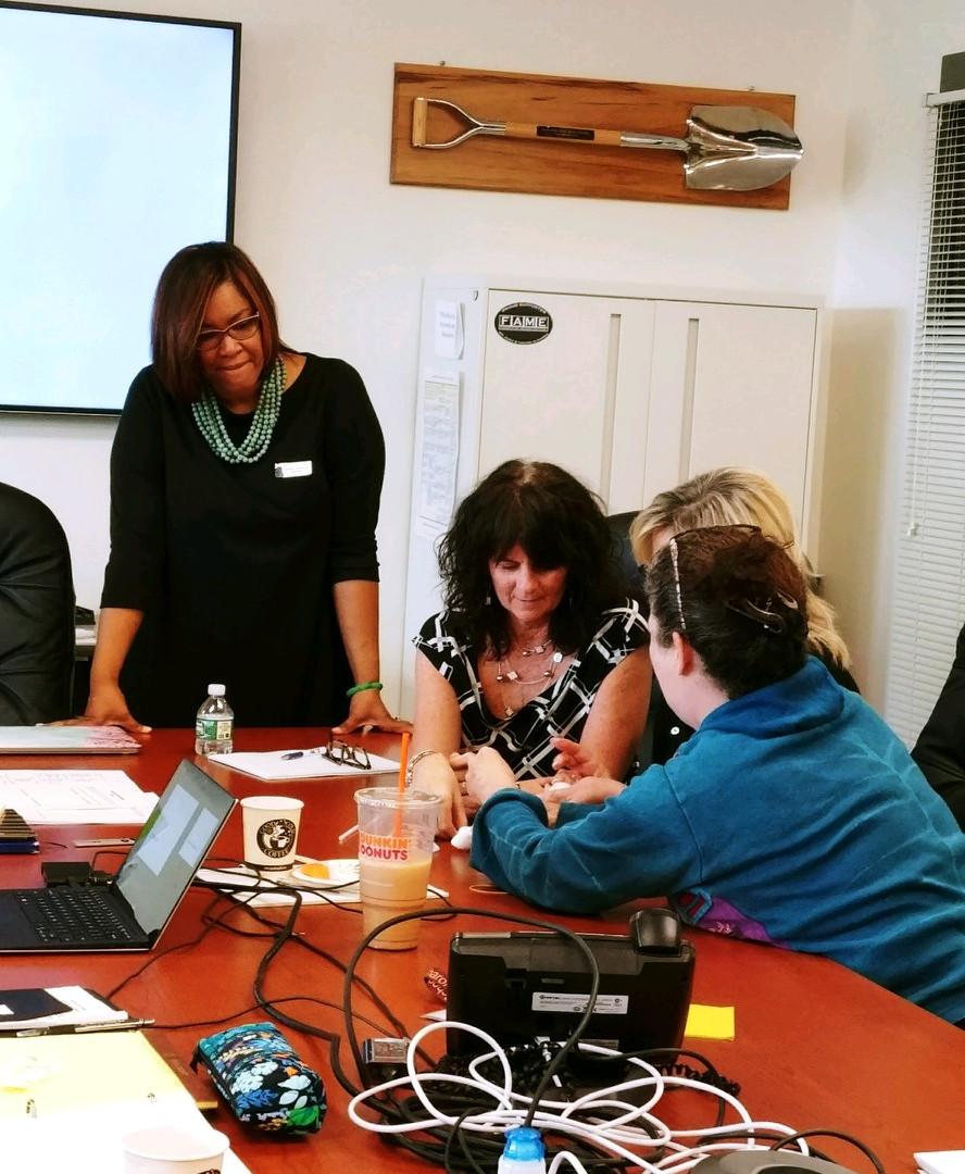 Dr. Elisa Norris oversees group activity at leadership seminar