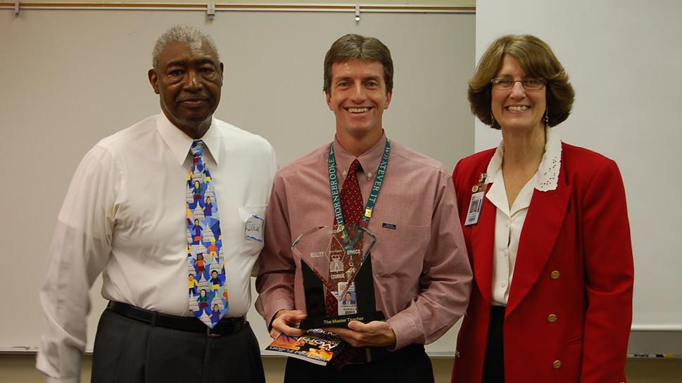 John Norris Presenting Award at Leadership Training Seminar
