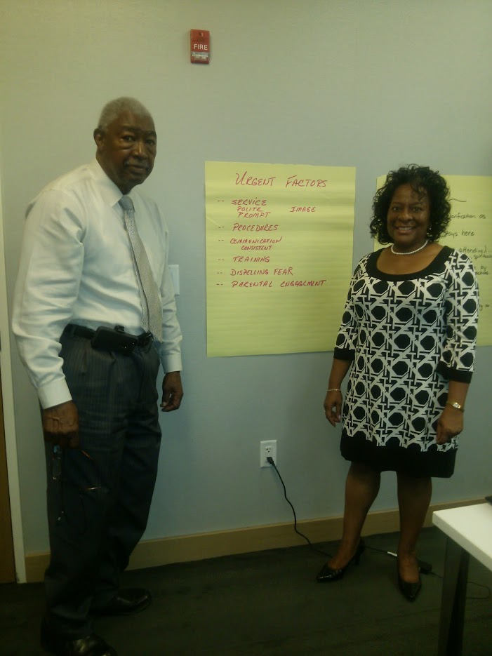 Faye Norris & John Norris deliver course material for leadership seminar