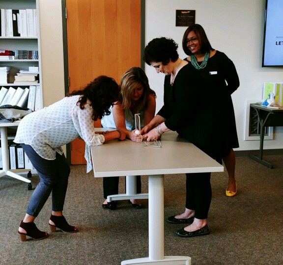Dr. Elisa Norris works with participants during leadership activity