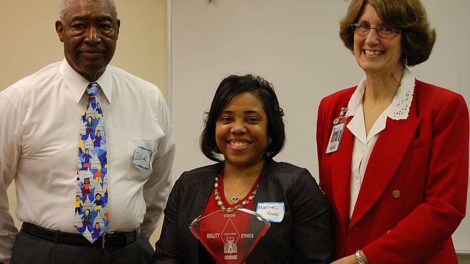 John Norris Presents Award to Participant of Leadership Seminar