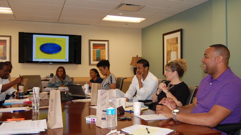 Dr. Elisa Norris in group discussion at leadership & diversity seminar