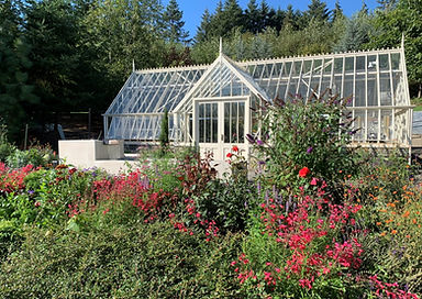 greenhouse front with flowers waterfall.jpeg