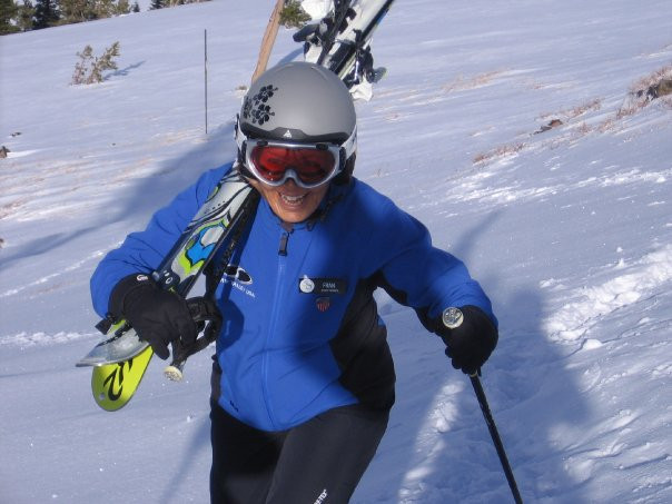 Fran hiking to ski