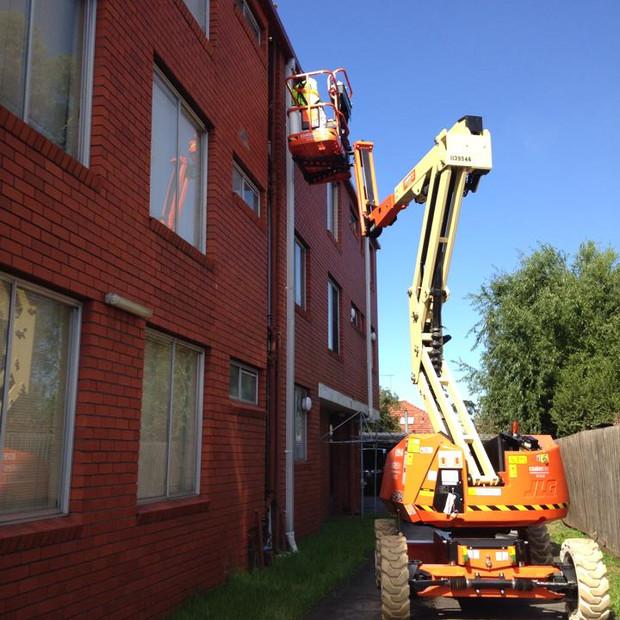 Exterior painting of apartment block