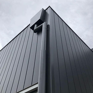 exterior cladding painted in colorbond monument