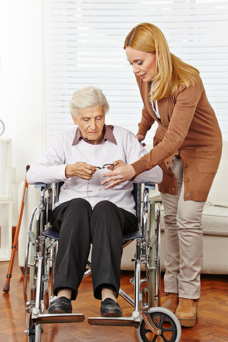 Woman helping senior citizen