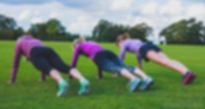 three-women-doing-push-ups-on-grass.jpg