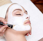 Cosmetologist_applying_skincare_treatmen