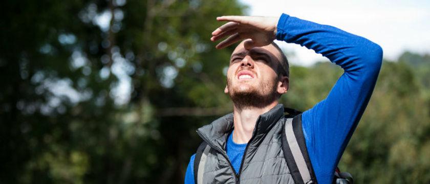 male-hiker-sielding-his-eyes.jpg