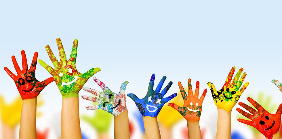 Image of human hands in colorful paint w
