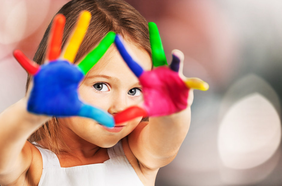 Little girl with painted hands.jpg