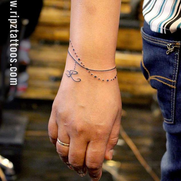Wristlet-tattoo-for-women-ripz-tattoo