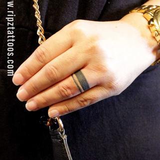 Finger-ring-tattoo-by-ripz-tattoo