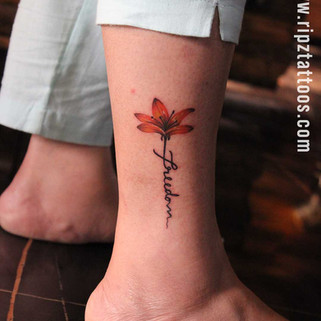 Colourful Flower Tattoo with Script by Ripz Tattoo