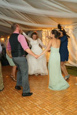 Bride dancing with her bridal squad