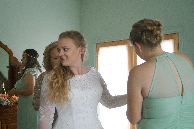 Bride being dressed