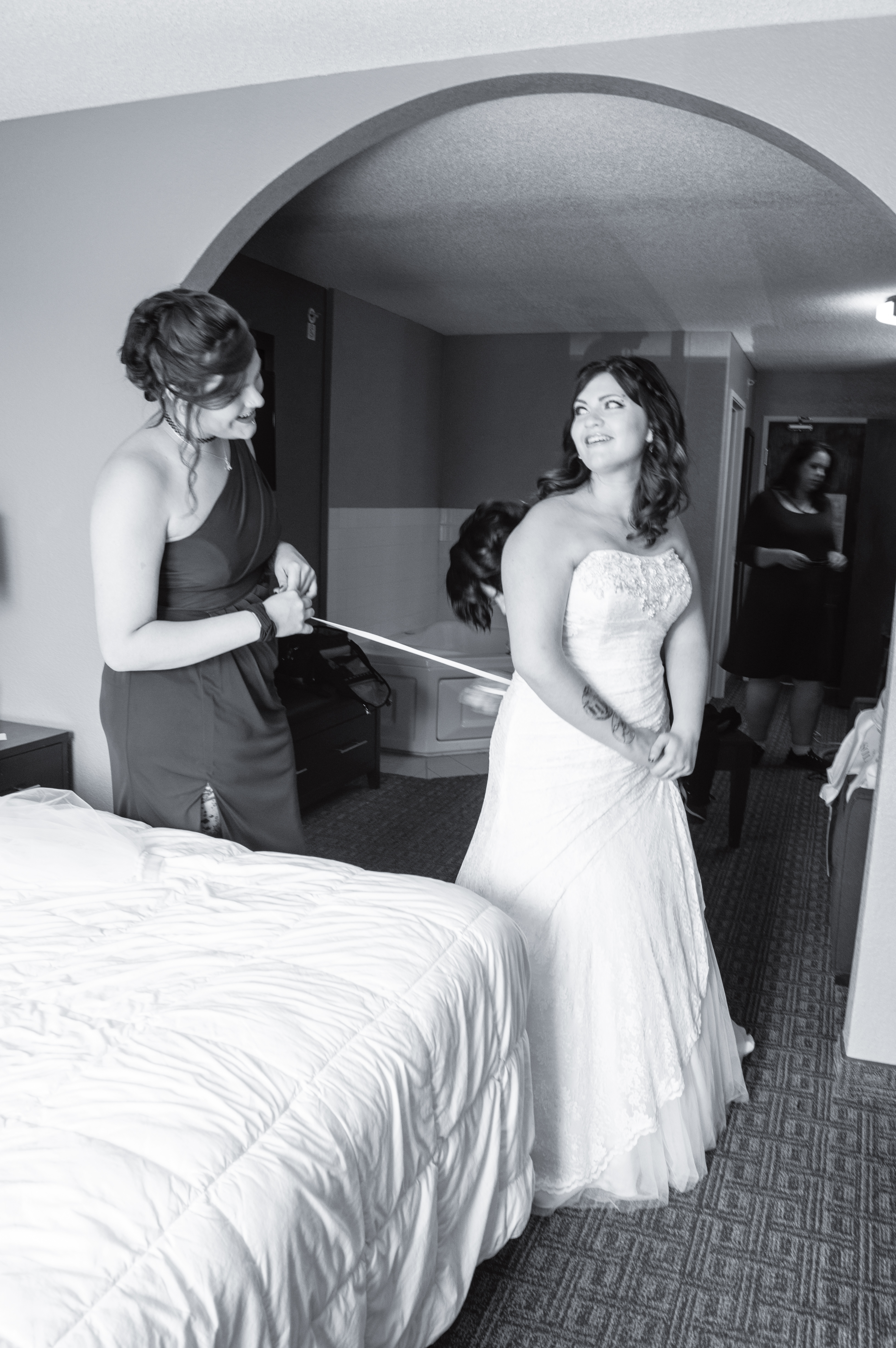 Maid of honor helping the bride