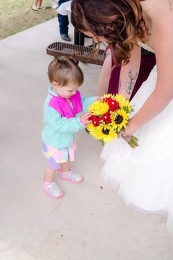 Wedding guest admiring bouquet