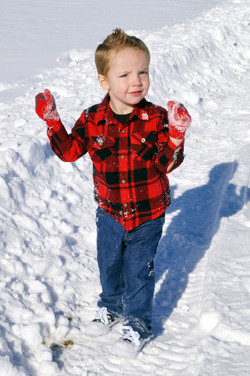Rylan playing with snow