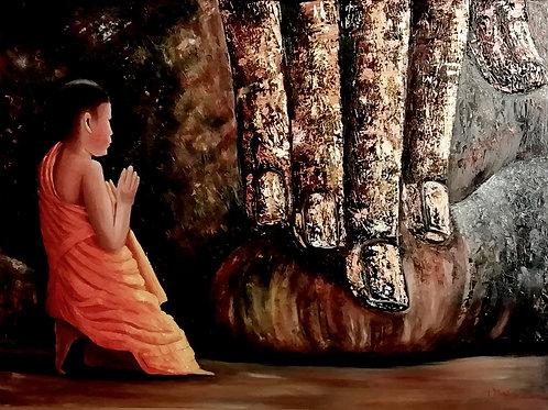 Praying young monk