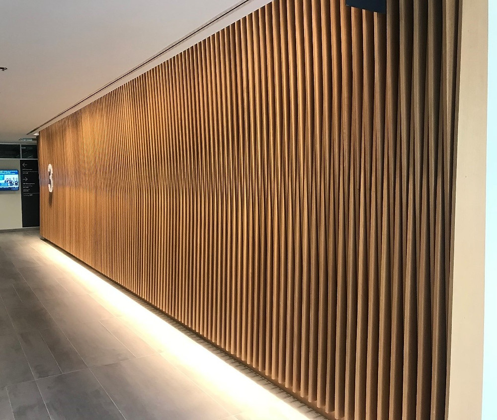 Wood slats applied at angles presents a variation of the design theme