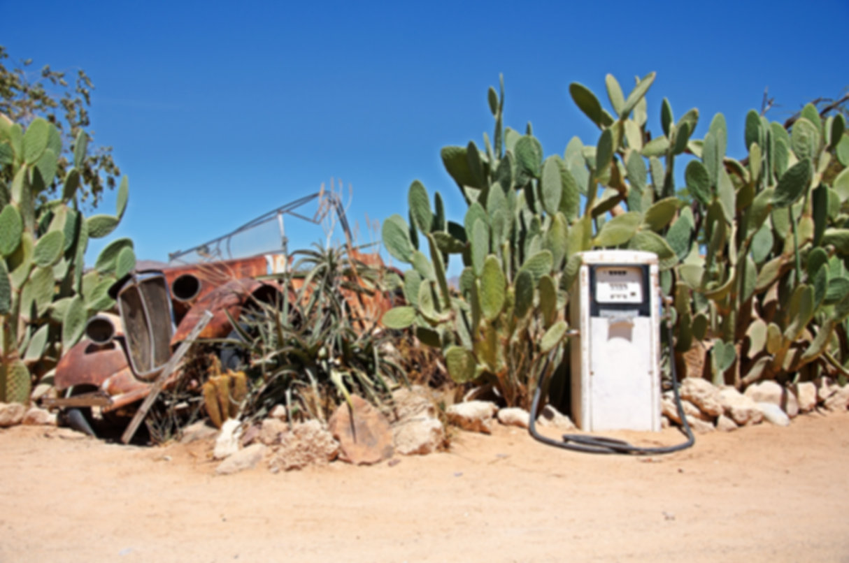 Old gas station with wreck of car.jpg