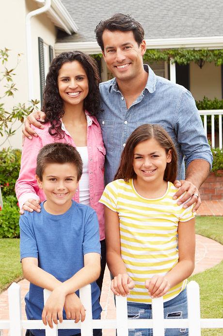 JBM Family in front of home AdobeStock_3