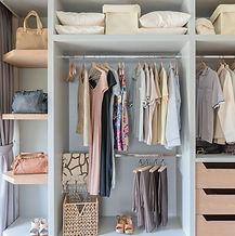 white wardrobe with shirts and pants han