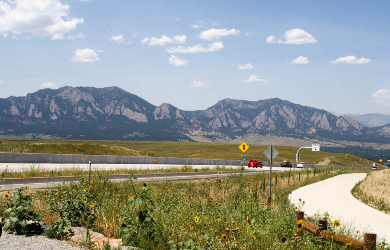 View to the Rocky Mountains from highway 36