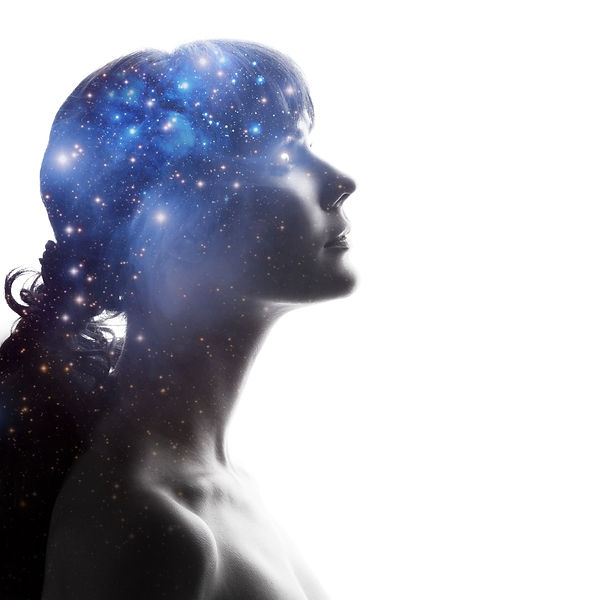 Profile of a woman with the cosmos as a