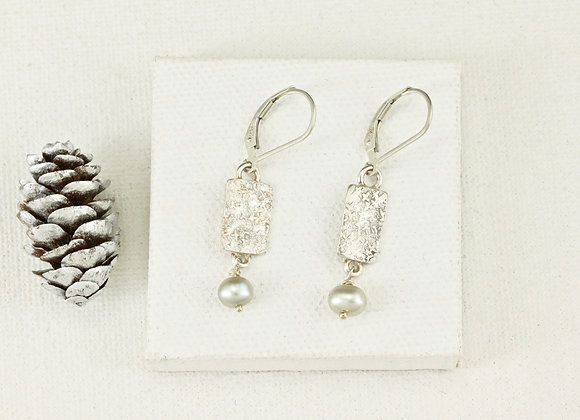 silver tablet with pale green pearl earrings