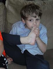 Ollie-biting-toenails-768x995.jpg