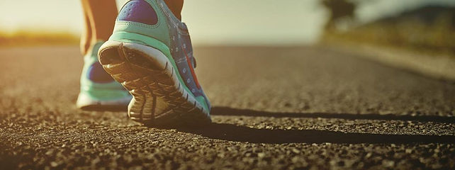 woman-running-down-road-1024x383.jpg