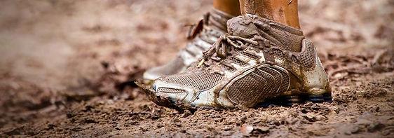 running-through-mud-1024x359.jpg