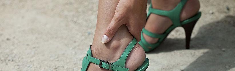 woman-holding-back-of-heel.jpg